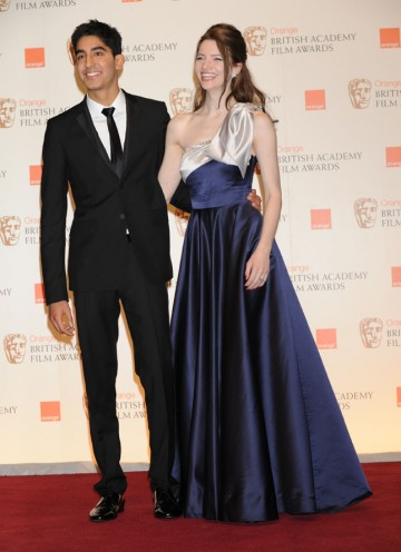 Dev Patel and Talulah Riley announced Alice In Wonderland as the Costume Design winner. (Pic: BAFTA/Richard Kendal)
