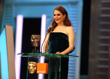 Julianne Moore (The Kids Are All Right) announces the Adapted Screenplay winner. (Pic: BAFTA/ Stephen Butler)