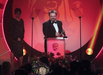 Editor Charlie Phillips accepts this Television Craft Award for his work on Sherlock (A Study In Pink). (Pic: BAFTA/Jamie Simonds)