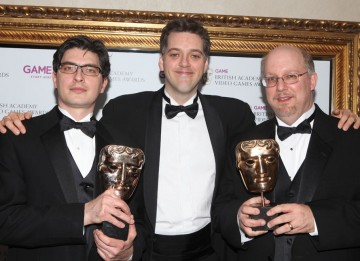 Presenter Iain Lee with the Strategy winners who helped create the fun and addictive turn-based Civilization V. (Pic: BAFTA/Steve Butler)