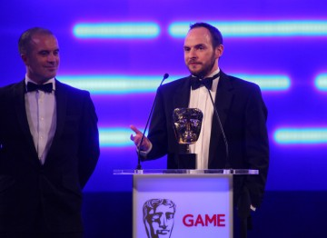 Some of the winning team behind Batman: Arkham City, the game's first award of the night.