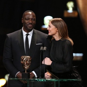 Adewale Akinnuoye-Agbaje and Laura Haddock present the BAFTA award for Best Documentary