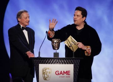 Comedian Dom Joly presents the award for best Strategy game along with Chris Deering, President of Sony Computer Entertainment Europe (BAFTA/Brian Ritchie)