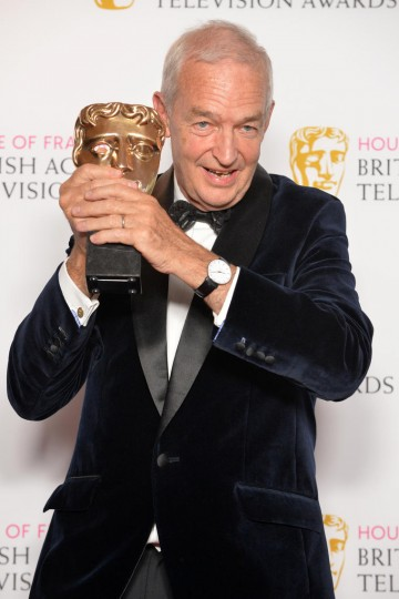 Jon Snow accepts the award for News Coverage for Channel 4 News: Paris Massacre