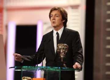 "Sir Paul McCartney presented the Original Music BAFTA and joked ""If I find my music is being used in a movie, I personally ring up the director to let him know how much I'm suing him for."" (Pic: BAFTA/Stephen Butler)"