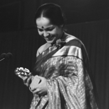 Rohini Hattangadi admires her BAFTA Awards, presented for her Supporting Actress role as Mrs Gandhi (1983).