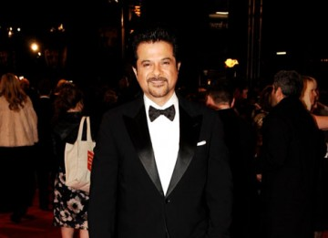 Slumdog Millionaire's gameshow host, Anil Kapoor, arrives to present the Costume Design category with Claire Danes (BAFTA/Richard Kendal).
