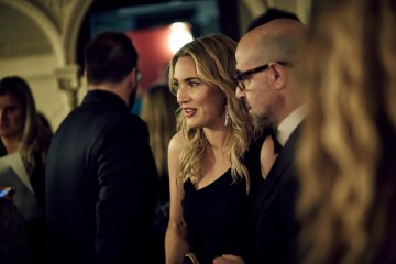 Kate Winslet and Stanley Tucci share a moment in the J.Kings Smoking Room at London's Royal Opera House