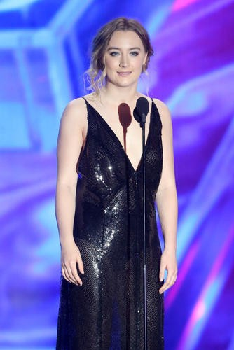 Actress Saoirse Ronan on stage presenting Spectre and Skyfall director Sam Mendes with the John Schlesinger Britannia Award for Excellence in Directing sponsored by the GREAT Britain campaign.