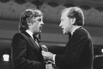 Michael Apted collects the Flaherty Documentary Award for 28 Up from David Frost in 1985.