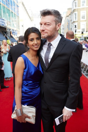 Nominee Charlie Brooker and wife Konnie Huq strike a pose on the red carpet. Suit and dress by House of Fraser