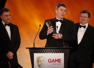 Piers Jackson, Mark Green and Leo Cubbin gratefully receive the award for best Handheld game: LittleBigPlanet (BAFTA/Brian Ritchie)