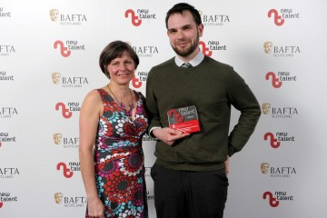 Pictured left to right - Presenter Kathy Friend and Steven Cameron Ferguson who won Camera/Photography for 'Sick'