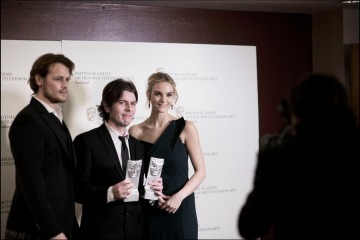 Paul Wright winner of Best Feature Film with guest presenters Sam Heughan and Joanna Vanderham
