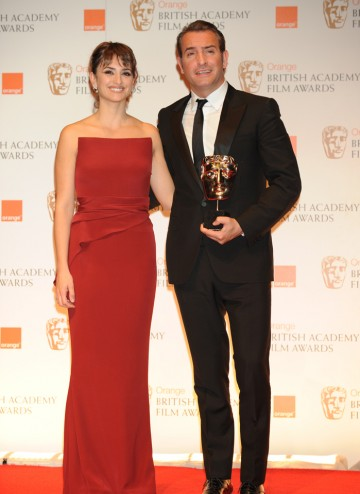 Presenter Penelope Cruz with the French actor who won for his performance as silent movie star George Valentin in The Artist.