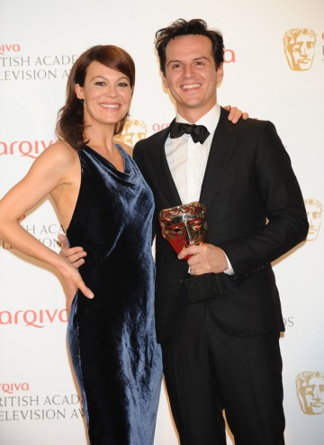Andrew Scott, winner of the Supporting Actor BAFTA for his performance as Moriarty in Sherlock, poses with presenter Helen McCrory.