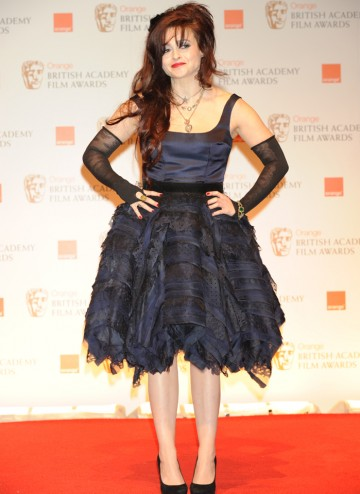 Helena Bonham Carter, wearing a dress by Giles Deacon, accepted the BAFTA on behalf of Christopher Plummer for his performance in Beginners.