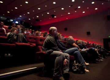 Audience members listen to a discussion about producing VFX on a low budget.