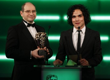 The Prince of Persia actor and Blitz Games exec announce the winner for Gameplay. (Pic: BAFTA/Brian Ritchie)