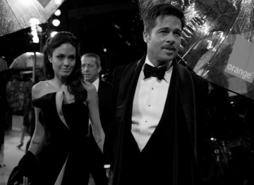 Angelina Jolie and her partner Brad Pitt making their way on the Red Carpet (Greg Williams / Art+Commerce).