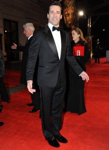 The Mad Men star, also seen in Bridesmaids and Sucker Punch last year, will present the BAFTA for Adapted Screenplay. Jon Hamm wears a suit designed by Tom Ford.