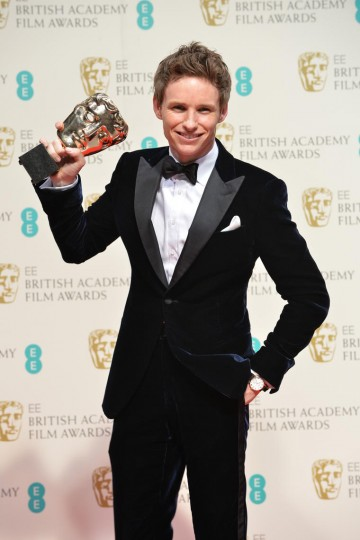 Leading Actor Eddie Redmayne celebrates the BAFTA for his role as Stephen Hawking in The Theory of Everything