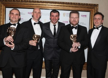 Presenter Joe Calzaghe with the winning team behind the fully immersive, ultra-realistic F1 2010. (Pic: BAFTA/Steve Butler)