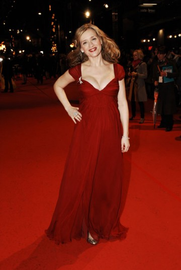 Anne-Marie Duff receives a Supporting Actress nomination for her role as John Lennon's volatile mother in Nowhere Boy. She takes to the carpet in a long red Alberto Feretti dress (BAFTA/Richard Kendal).
