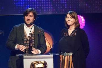 Paul King and Rosie Alson collect the BAFTA for Feature Film at the British Academy Children's Awards in 2015 for Paddington