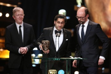 Asif Kapadia and James Gay-Reese take to the stage to accept the BAFTA award for Best Documentary