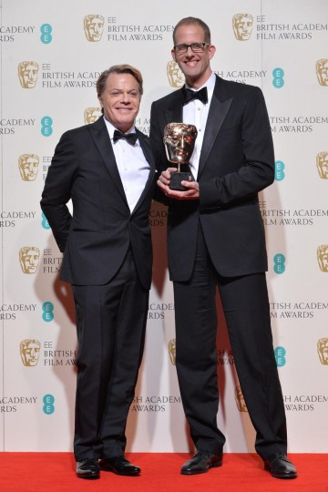 Pete Doctor, winner of the Animated Film award for Inside Out. Pictured with presenter Eddie Izzard