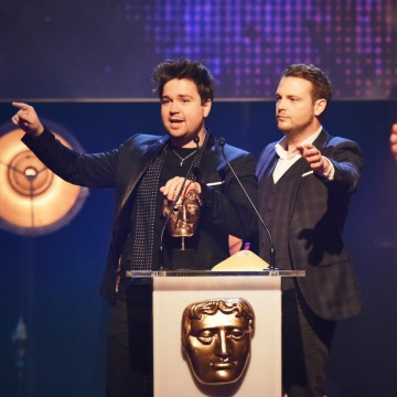 Sam Nixon and Mark Rhodes collect the BAFTA for Presenter at the British Academy Children's Awards in 2015