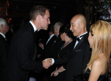 The Duke of Cambridge greets Mr. and Mrs.Kim, owners of the Belasco Theatre