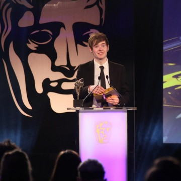 Dan Middleton presents the Ones to Watch Award at the British Academy Games Awards Ceremony in 2015