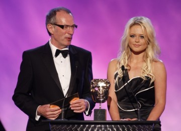 Inbetweeners star Emily Atack and legendary video game artist Dave Gibbons present the Award for Artistic Achievement (BAFTA/Brian Ritchie)