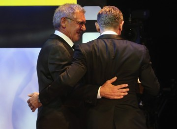 Daniel Craig  and Harrison Ford walk off stage at the Britannia Awards.