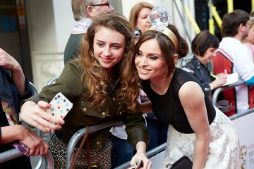 Sophie Ellis Bextor takes a picture with a fan before the House of Fraser British Academy Television Awards