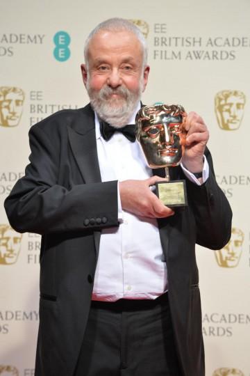 BAFTA Fellow Mike Leigh celebrates his award backstage