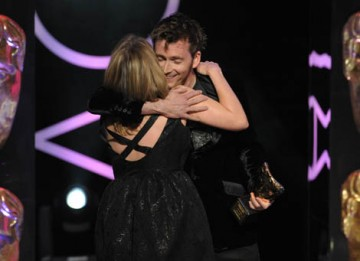 David Tennant congratulates Jane Tranter on stage after presenting her with the Special Award for outstanding creative contribution to the television industry (BAFTA / Marc Hoberman).