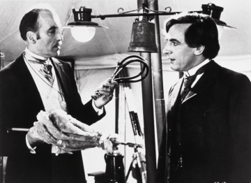 Christopher Lee as Mycroft Holmes with Robert Stephens who played Sherlock Holmes. Pic: SNAP/ REX Features