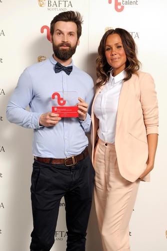 Michal Wdowiak - Winner in the Editor Category for 'Yogi' with presenter Jean Johansson
