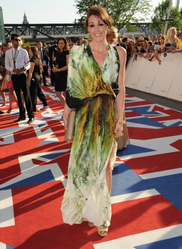 The Scott and Bailey star, dressed in a beautiful gown by Maria Grachvogel, arrives at the ceremony, with the show nominated in the Drama Series category.