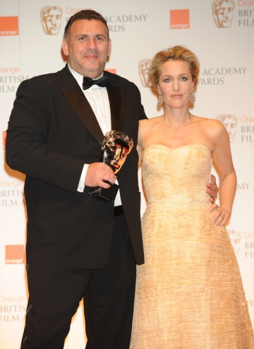 Presenter Gillian Anderson with Rango producer Graham King.