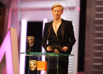 Tilda Swinton (I Am Love) reveals the winning director. (Pic: BAFTA/ Stephen Butler)