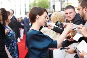 Jessica Reine providing autographs before the House of Fraser British Academy Television Awards