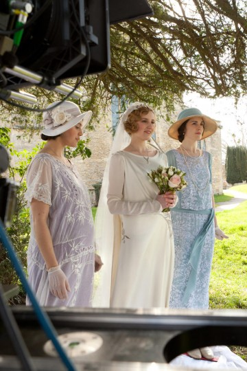 A behind the scenes photograph from season three of Downton Abbey.The three Crawley sisters, played by Jessica Brown Findlay, Laura Carmichael and Michelle Dockery, are pictured here before Edith's wedding.