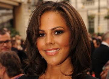 Famed for her curly hair, stylists gave Lenora Crichlow softer waves at the 2011 Television Awards for a more sophisticated look.
