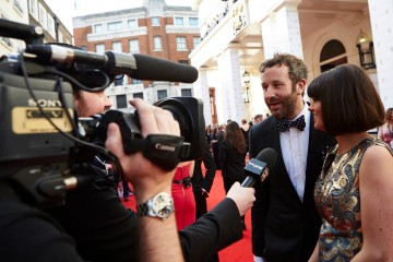 Chris O'Dowd and Dawn O'Porter are interviewed outside London's Theatre Royal