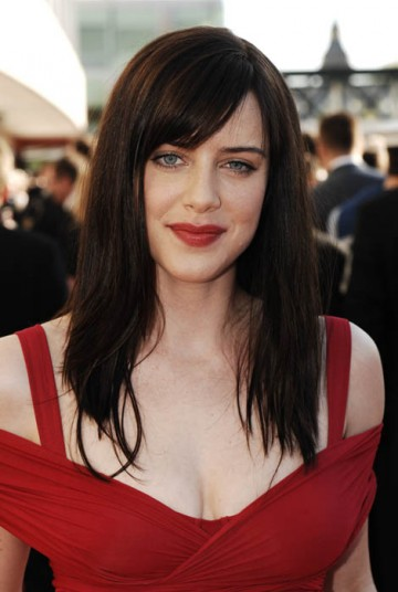 Doctor Who starlet Michelle Ryan matched the red carpet in a striking gown by Donna Karan and ruby red lips (BAFTA / Richard Kendal).