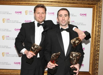 Evan Welles and Christophe Balestra celebrate their four BAFTAs for Uncharted 2: Among Thieves including masks in the Use of Audio, Original Score, Story and Action categories (BAFTA/Steve Butler).